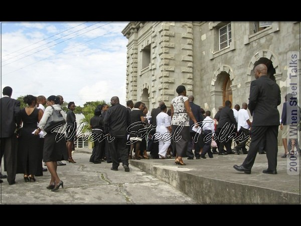 Attendees making their way inside the church upon the arrival of casket, family, friends and fraternity