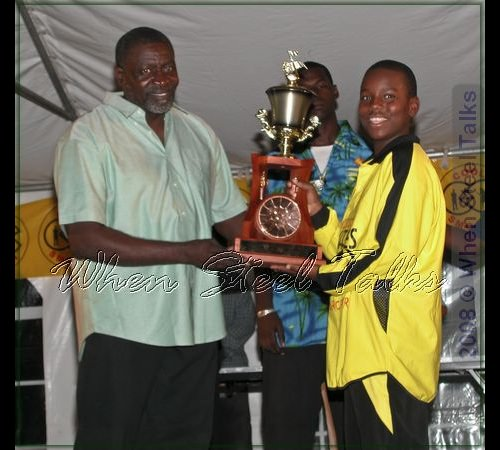 Ebonites receive third place prize trophy from member of Gemonites management team, Tennessee-based Antiguan Vere Henry