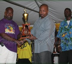 Hell's Gate arranger and tuner, Veron Henry, receives runner-up trophy