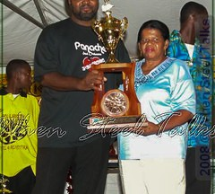Second place winners Panache receive trophy from Mrs. Curlita Gordon
