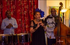 """Hazel Beckles Younglao welcomes attendees to the inaugural """"Carib Parlor Notes"""" held at her home..."""
