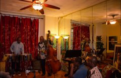 """Taking in the performance at the inaugural """"Carib Parlor Notes"""""""