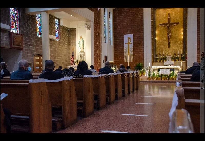"""Attendees at the service celebrating the llife of Martin """"Dougie"""" Douglas; alternate pews cordoned off in keeping with COVID-19 protocol"""